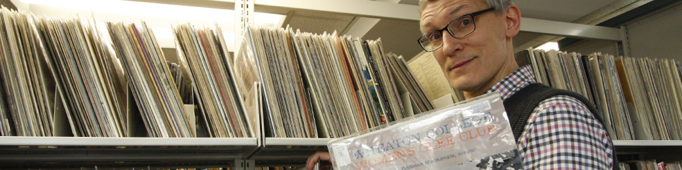 Librarian browsing musical scores