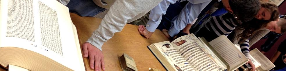 Visitors looking at rare books
